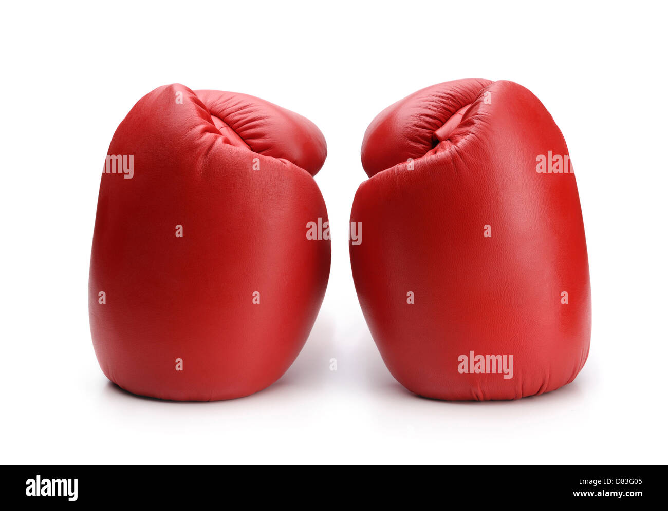 Red boxing gloves isolated on white background - Stock Image