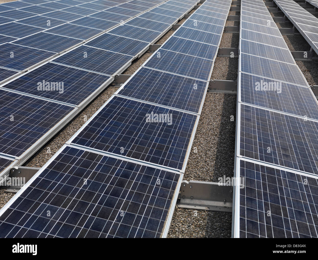 Solar panels on a roof of building - Stock Image