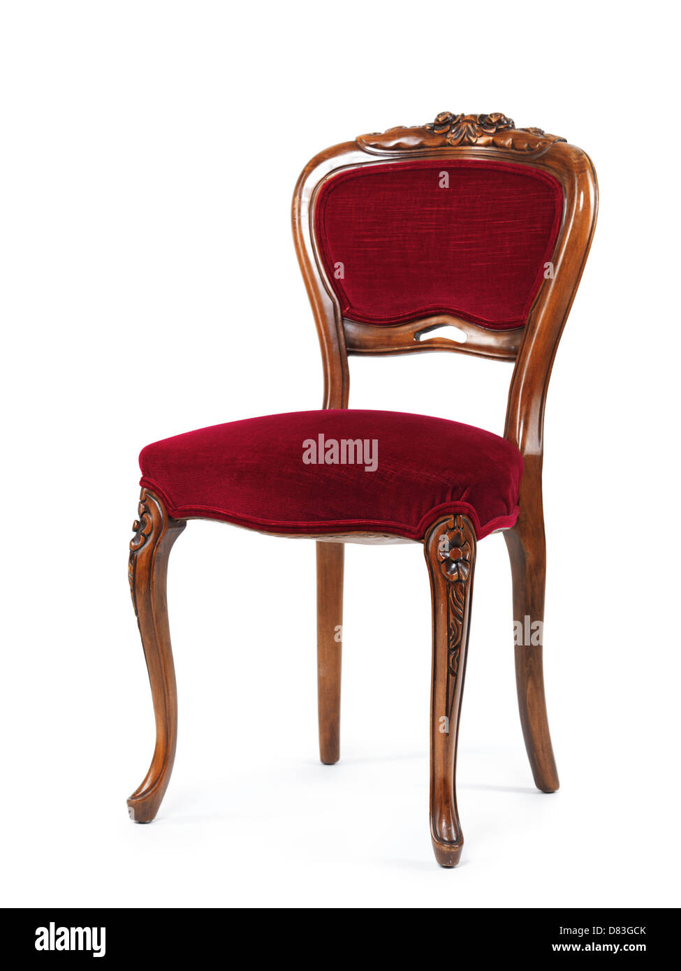 Antique wooden chair with red upholstery isolated on white background - Stock Image