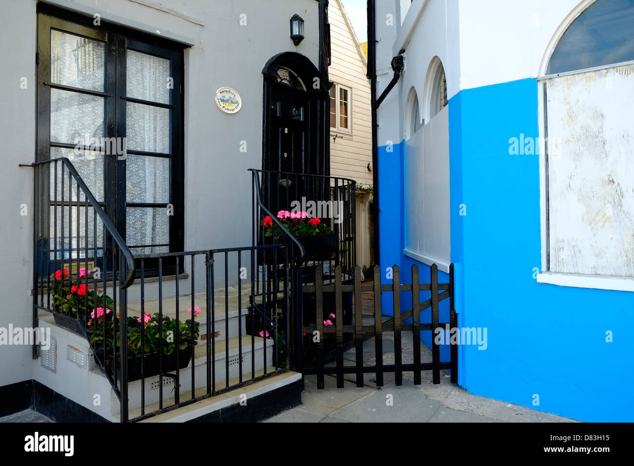 Secluded corner cottages on Hastings seafront East Sussex England UK - Stock Image