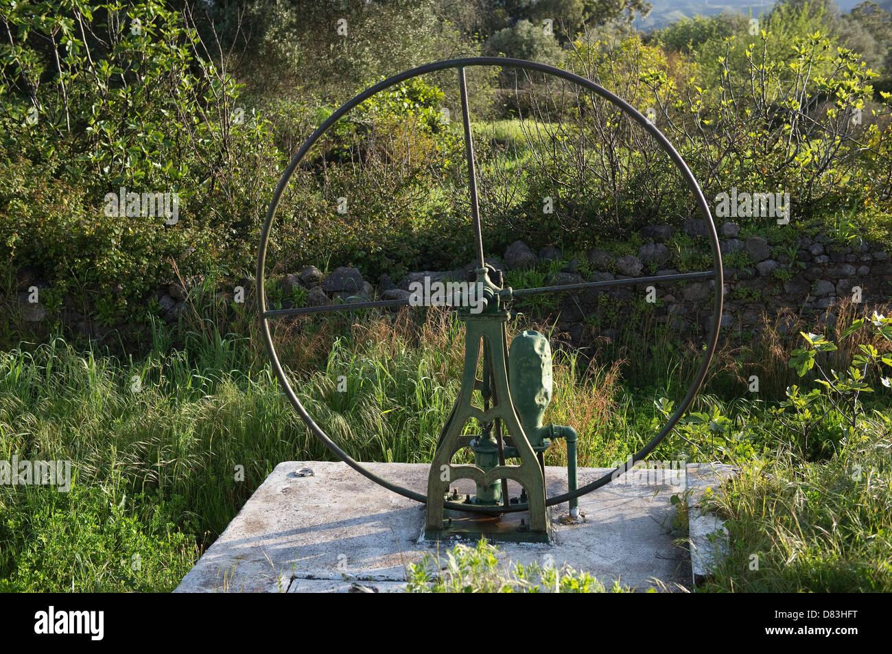 Old iron waterwheel Ferrobo village Sao Bras de Alportel Algarve Southern Portugal Mediterranean Europe - Stock Image