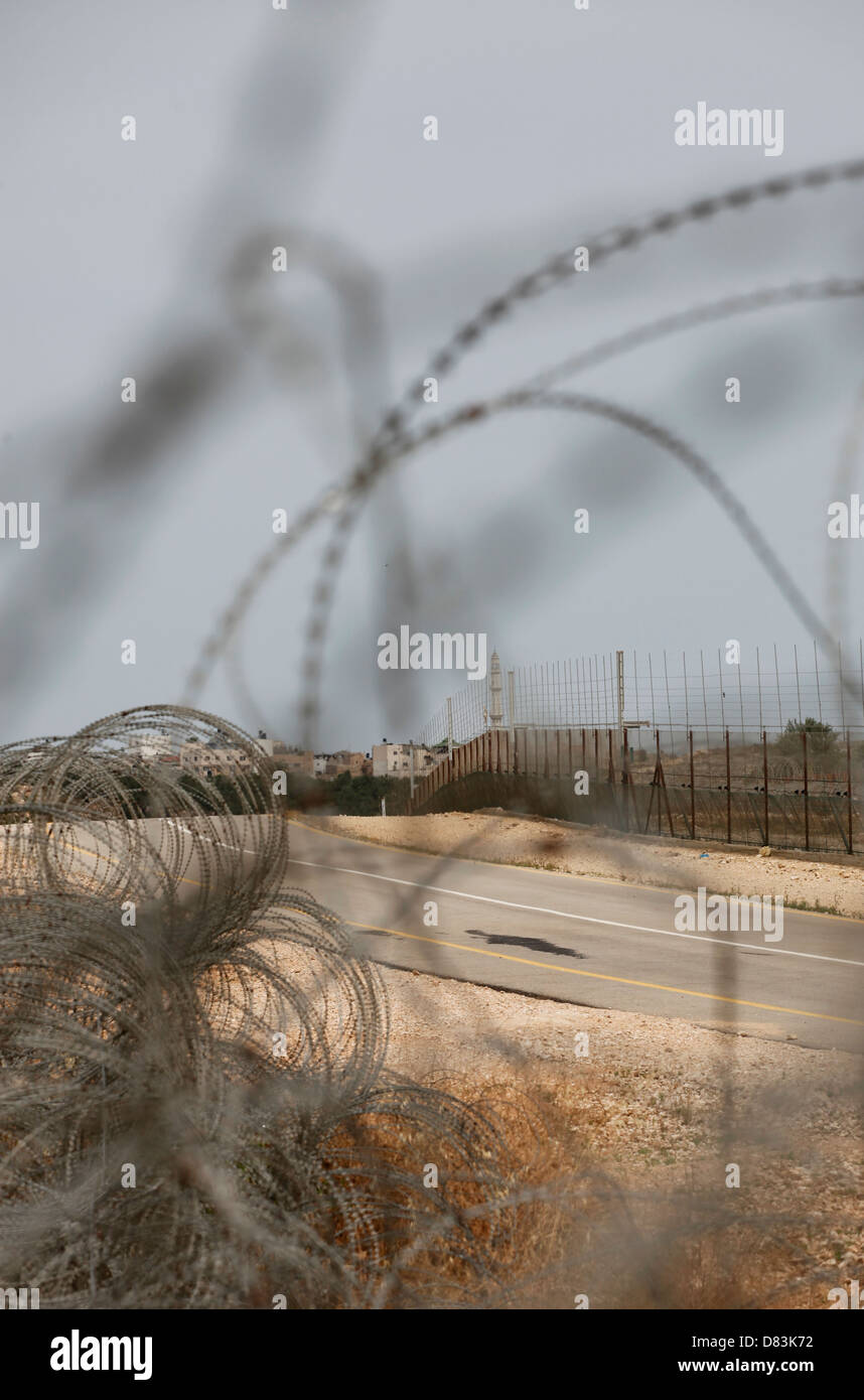 Barbed wires surrounding the religious Jewish settlement Modi'in Illit in the West Bank Israel - Stock Image