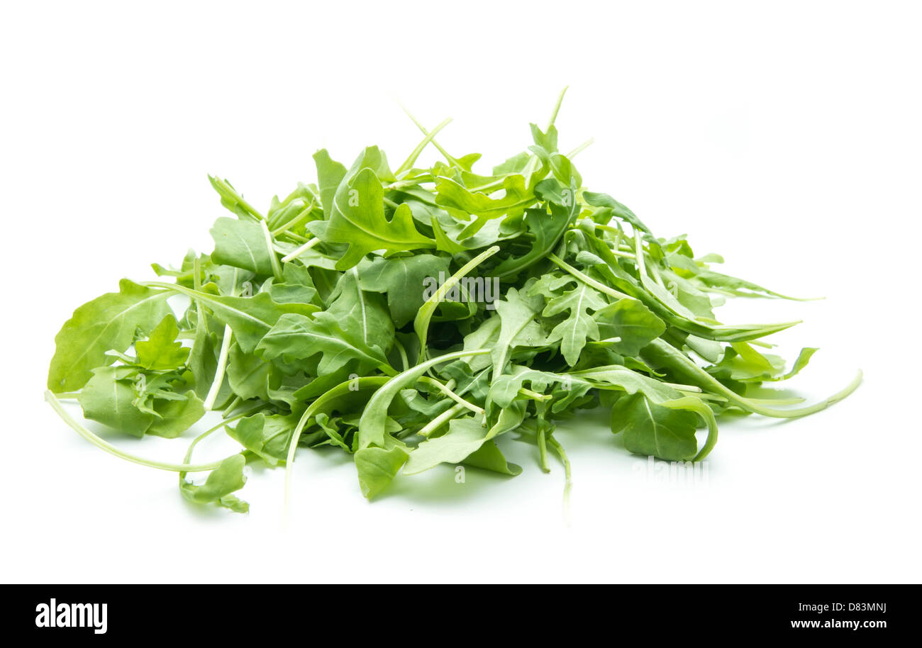heap of rucola leaves isolated on white background - Stock Image