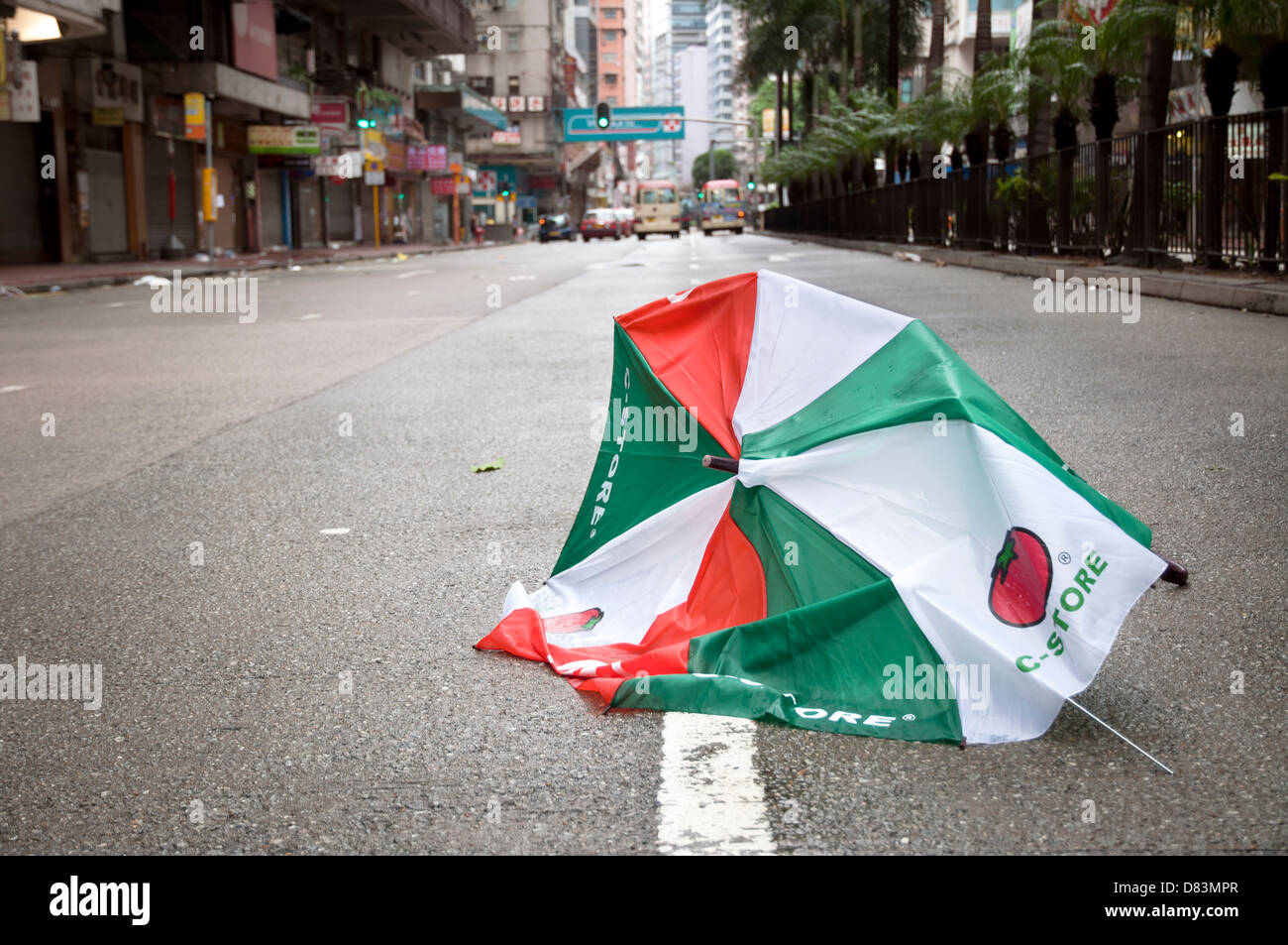 Broken umbrella in Hennessey Road after a tropical storm, Hong Kong - Stock Image