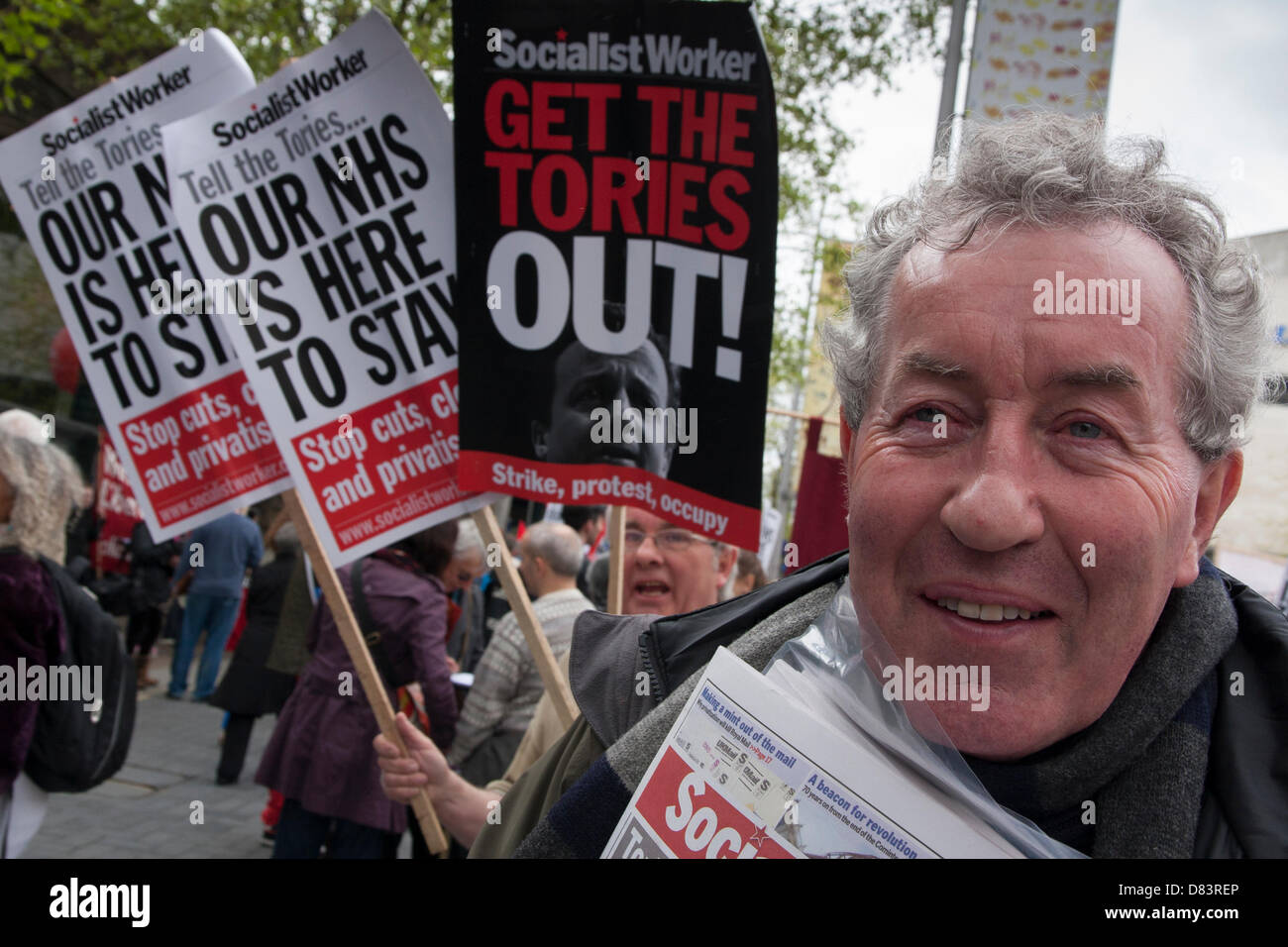 London, UK. 18th May 2013. London. A protester waits for the march against NHS cuts and privatisation of essential - Stock Image