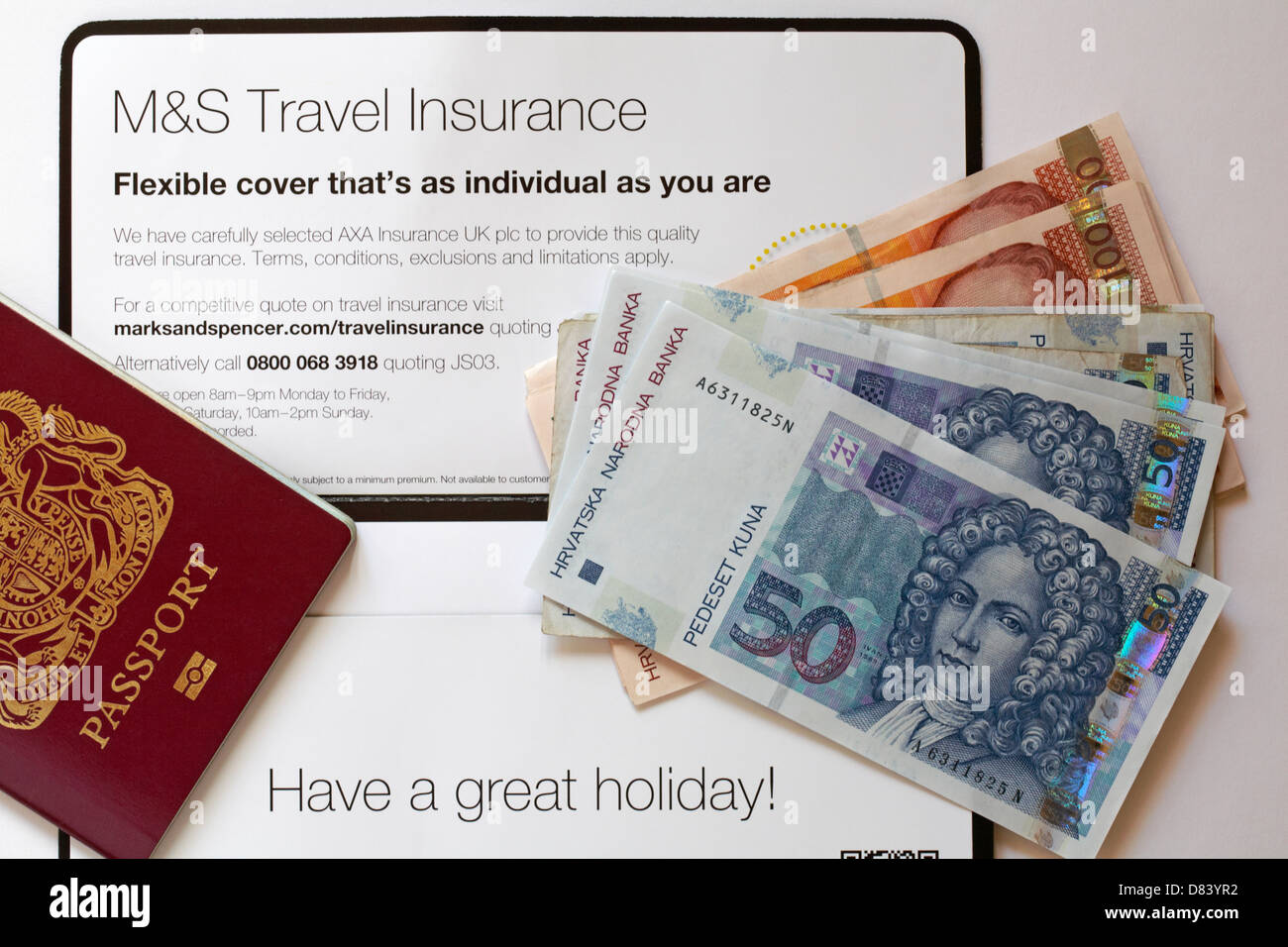 Have a great holiday - M&S Travel Insurance, passport and foreign currency for holiday in Croatia - Stock Image