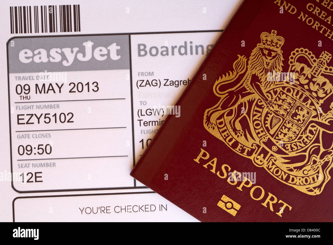 passport and Easyjet boarding pass for flight to Zagreb in Croatia - Stock Image