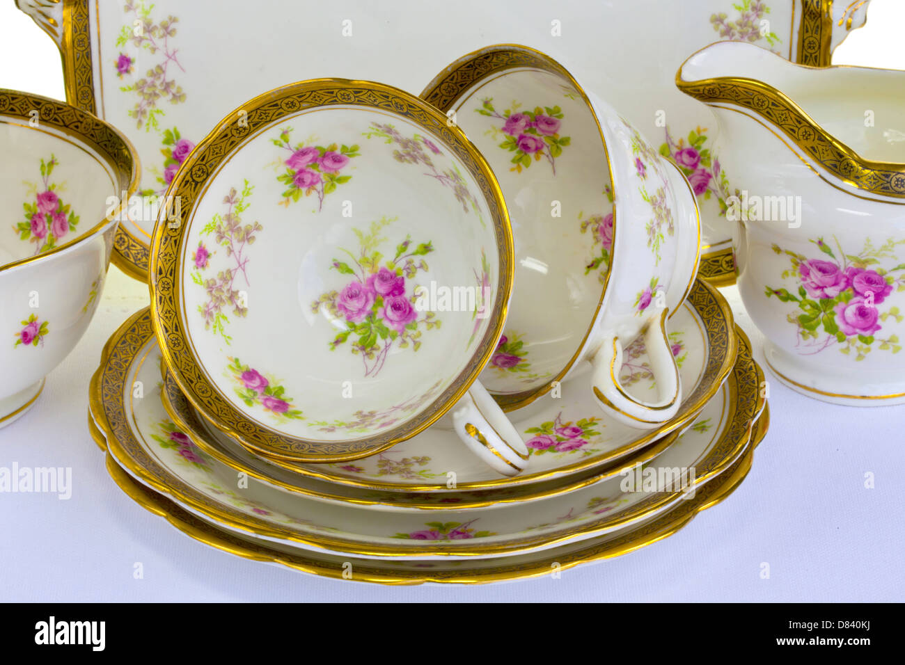 Close-up of dainty antique china tea cups saucers and small plates. & Close-up of dainty antique china tea cups saucers and small plates ...