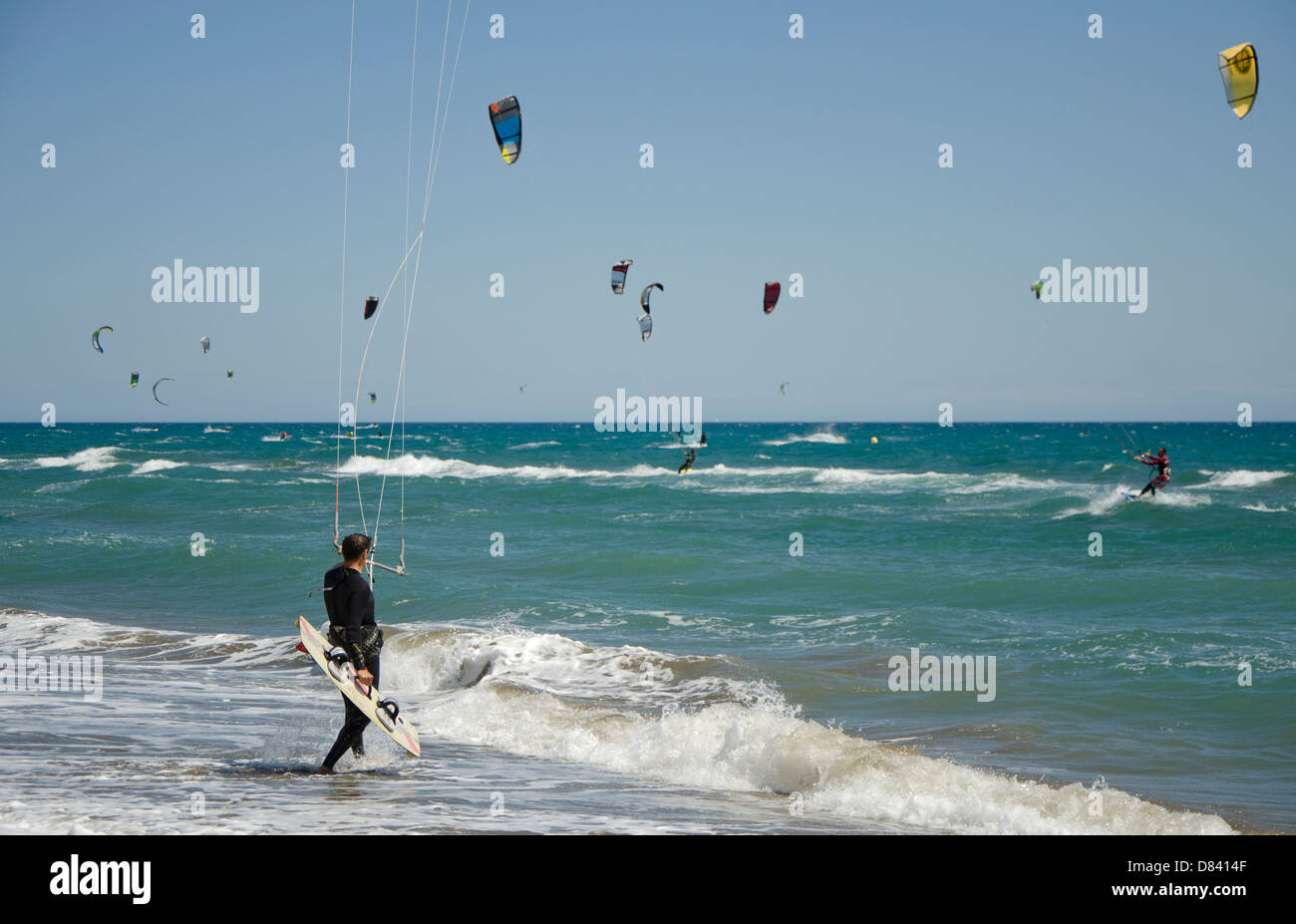 Kitesurfers at beach, Marbella, Spain. - Stock Image