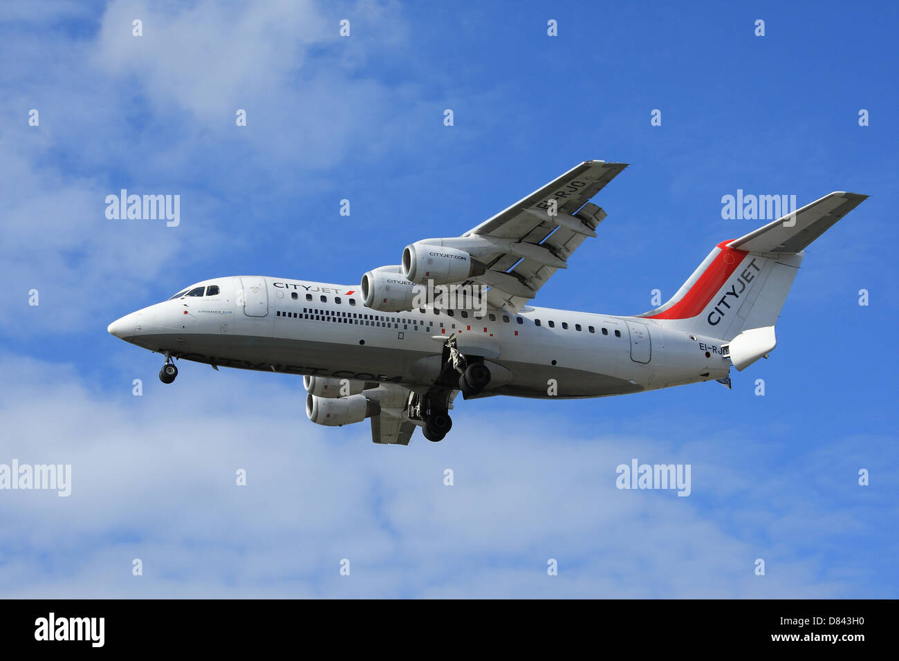 British Aerospace Avro RJ85 CityJet airline on approach to London City Airport - Stock Image