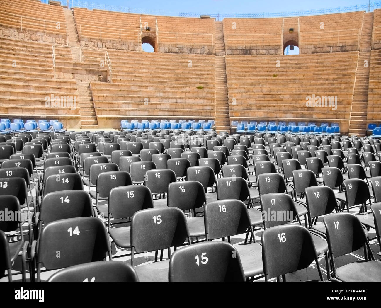 Modern plastic seats in Roman ancient amphitheater - Stock Image