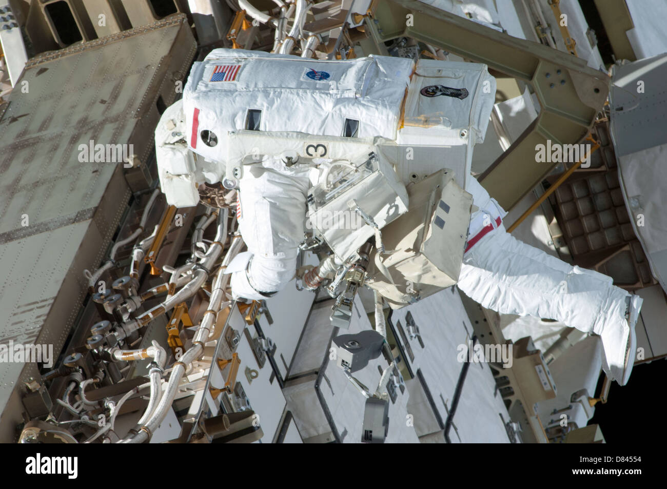 International Space Station Expedition 35 astronaut Chris Cassidy conducts a space walk to inspect and replace a - Stock Image