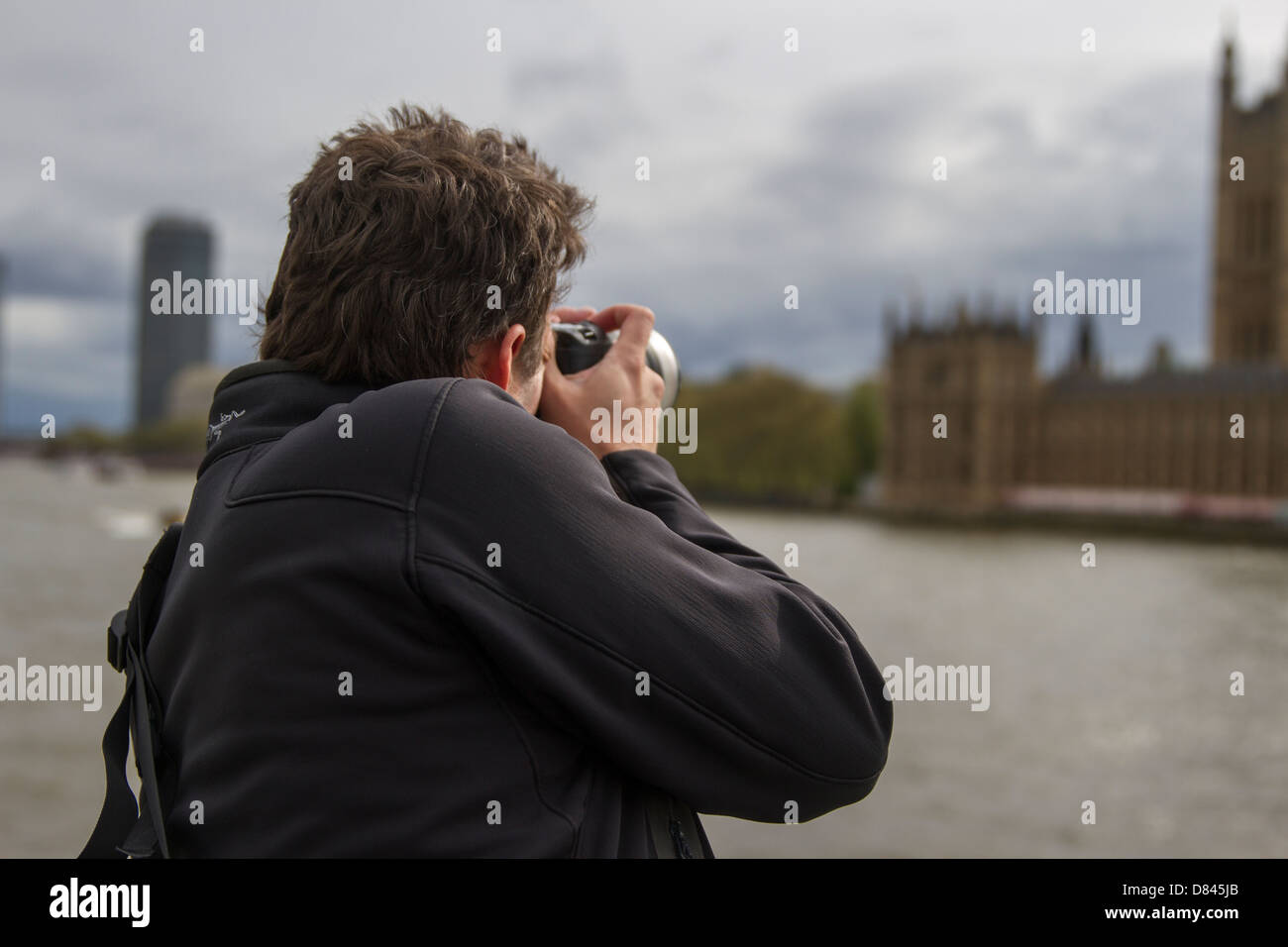Photographer taking pictures of Parliament - Stock Image