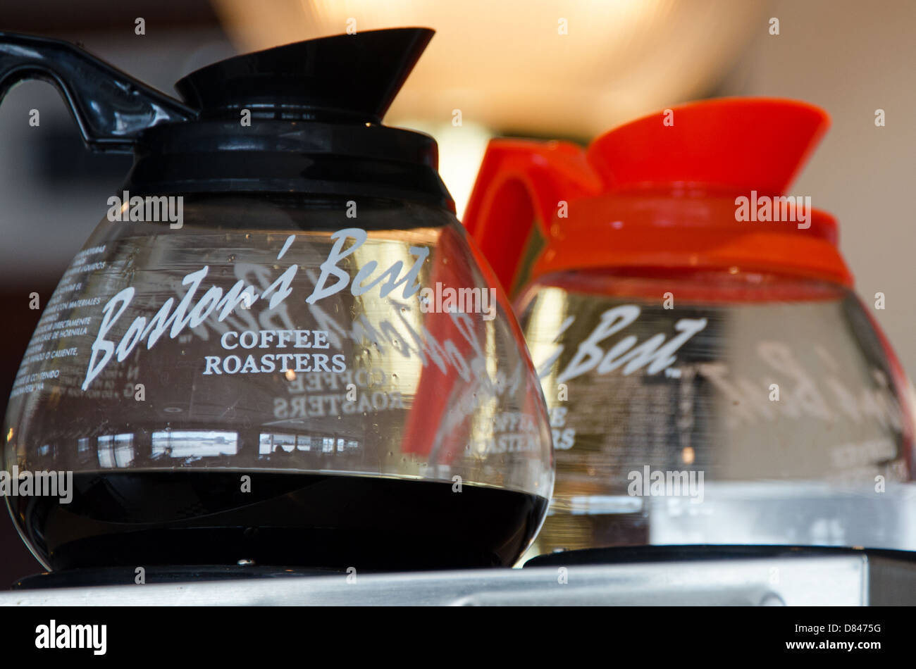 Closeup of two pots of coffee in a diner - caff and decaf. - Stock Image
