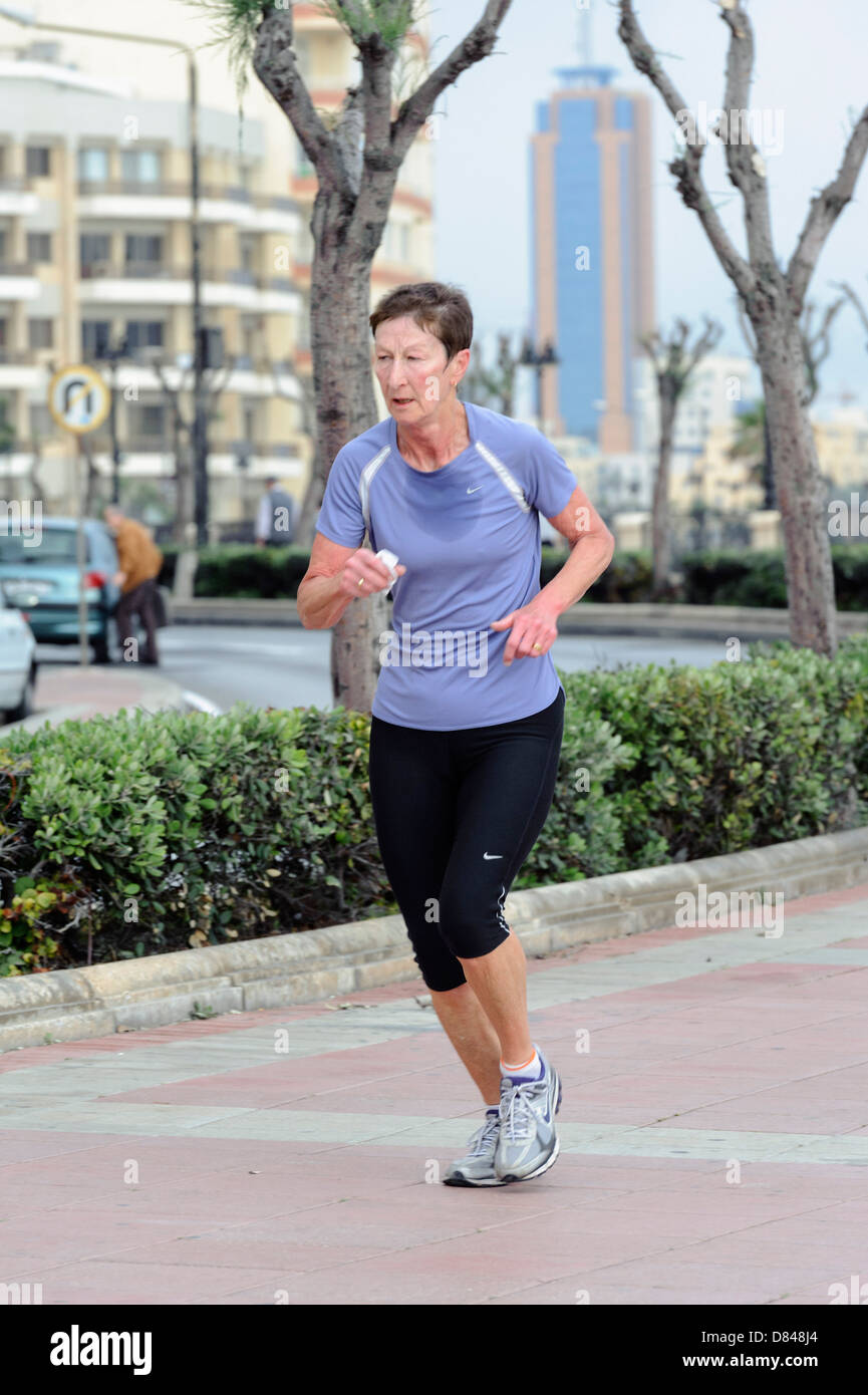 Jogger at Peace Boulevard an the boardwalk in Sliema, Malta - Stock Image