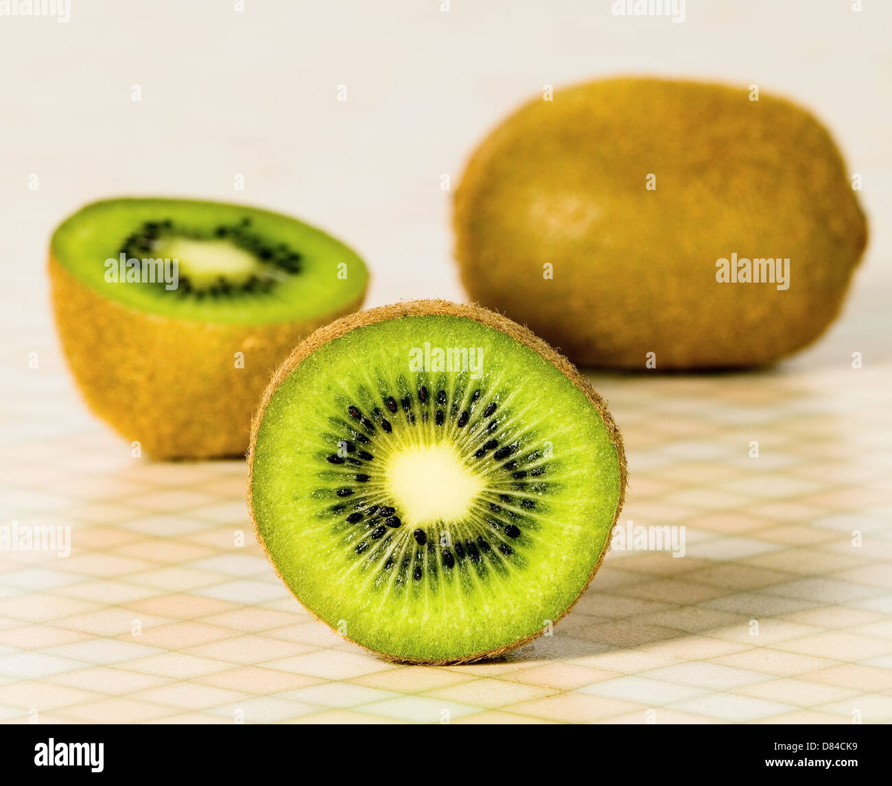 Green fruit kiwi place on the table - Stock Image