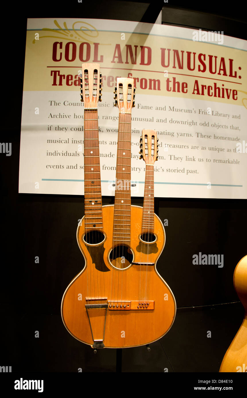 Tennessee, Nashville. Country Music Hall of Fame. Unusual three-necked guitar. - Stock Image