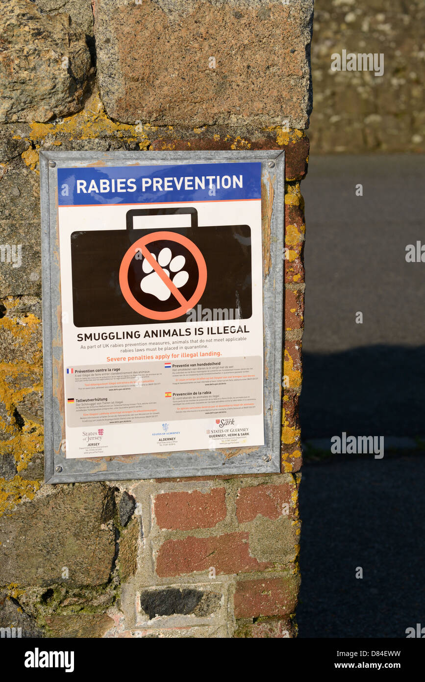 Rabies prevention sign in St Peter Port harbour, Guernsey - Stock Image