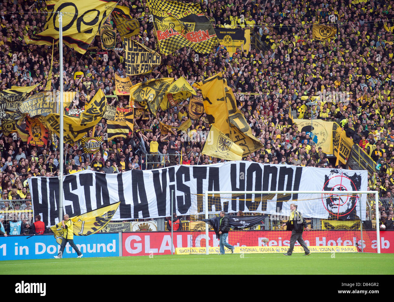 Dortmund S Fans Show A Banner Hasta La Vista Hopp Prior To The Stock Photo Alamy