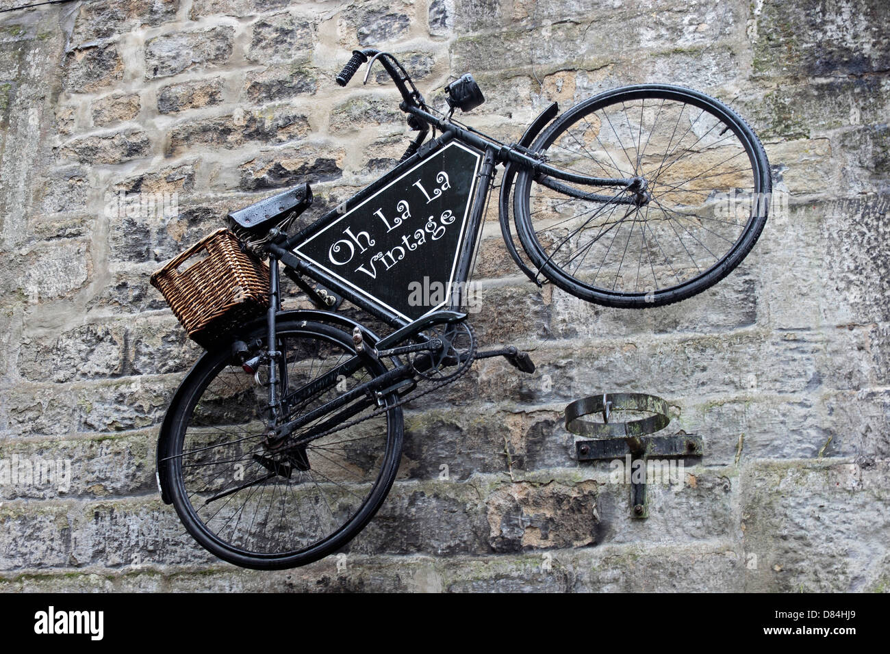 Haworth 40's Weekend vintage bicycle hung on stone wall of Oh La La shop - Stock Image