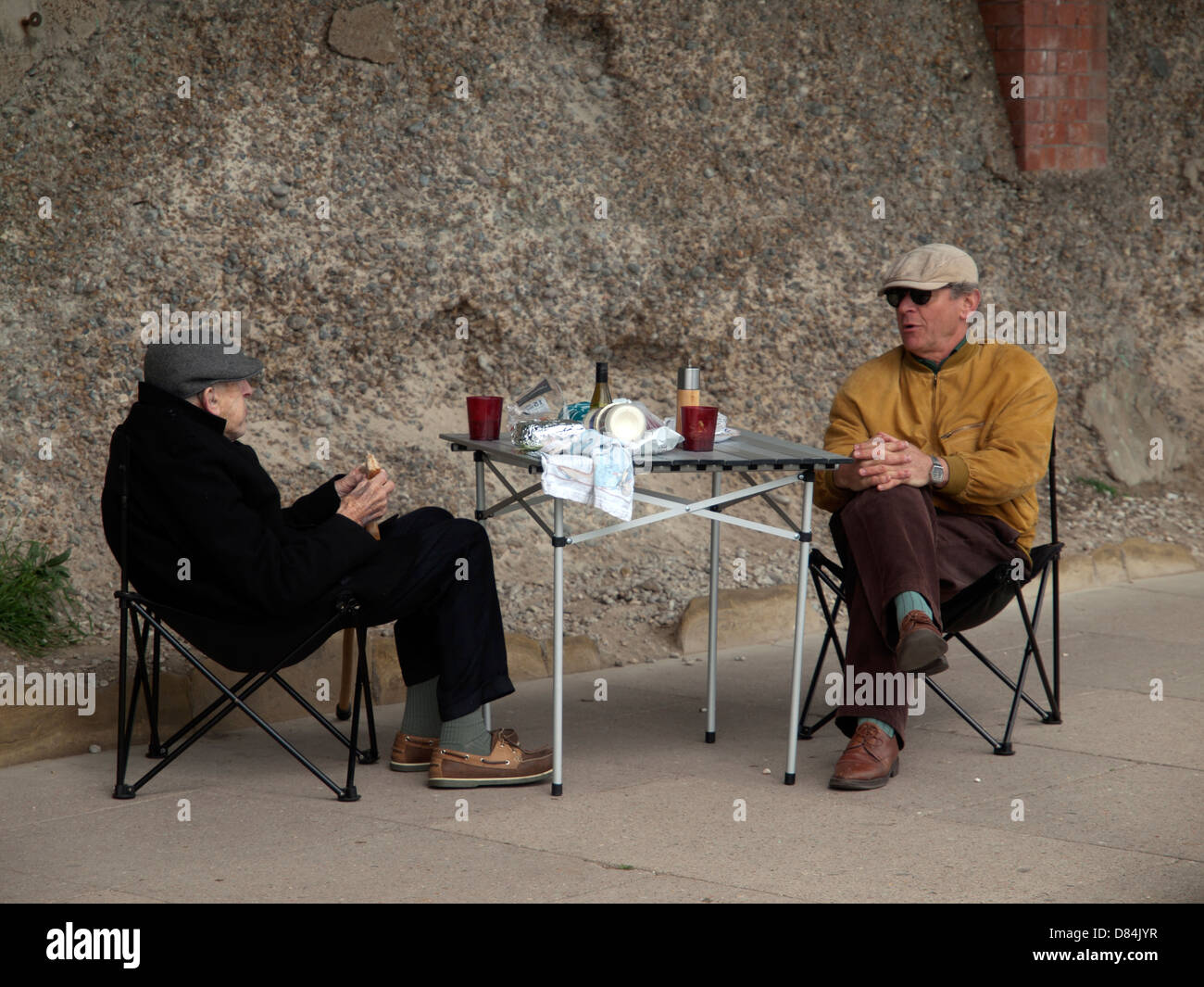 A picnic for two men in Brighton - Stock Image