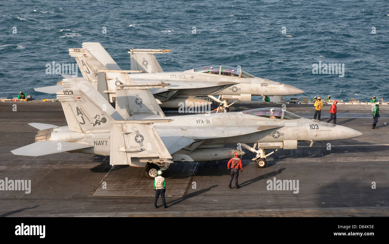 Two F/A-18 Super Hornet aircraft on the flight deck of USS George H.W. Bush. - Stock Image