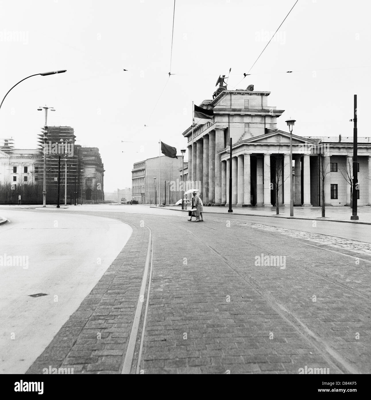 March 1959, Tram tracks, 18th of March square and Brandenburg gate, East Berlin, Germany, Europe - Stock Image
