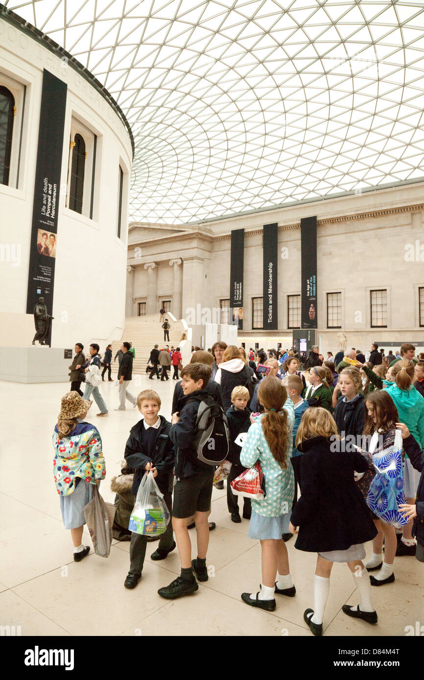 Children on a school trip tour to the British Museum in the great court, London UK - Stock Image