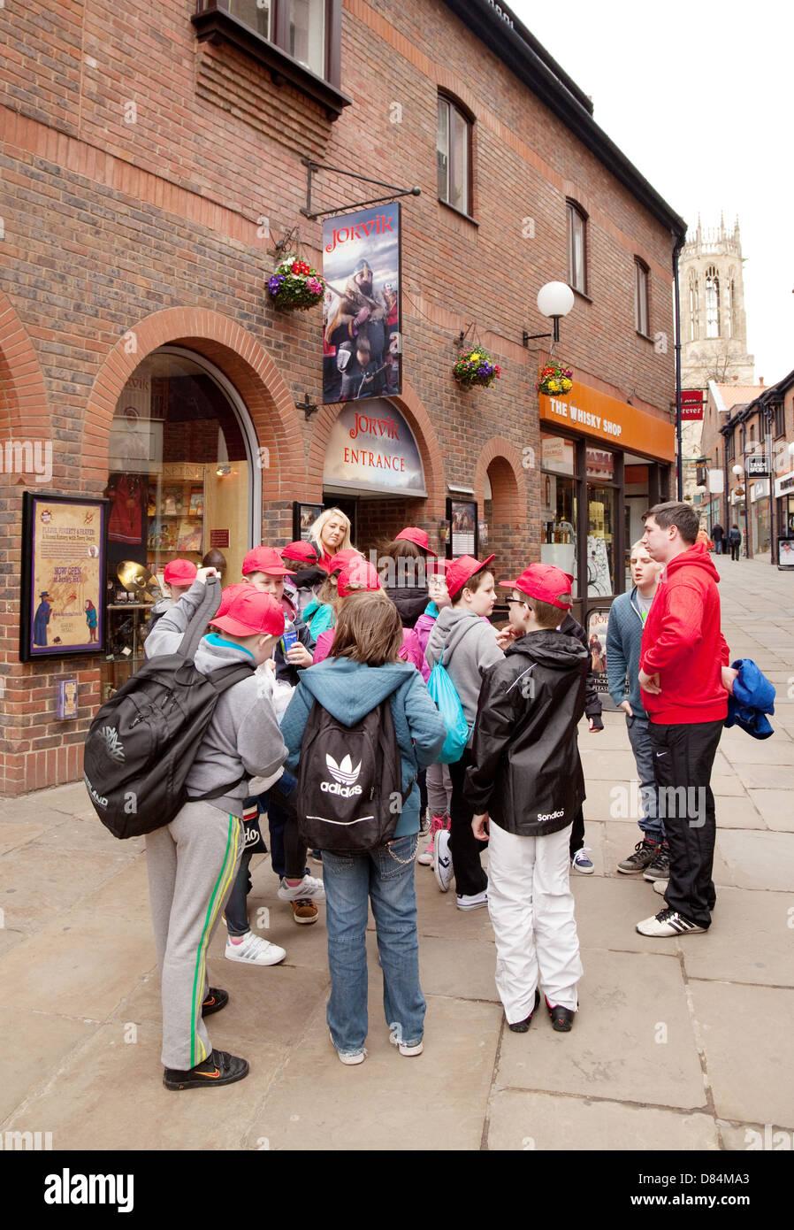 School children on a school trip waiting to enter the Jorvik Viking Centre, York, yorkshire, UK - Stock Image