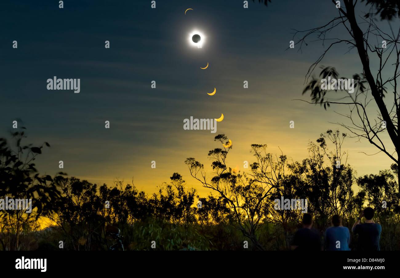 Solar eclipse composite with observers, Mulligan Highway, Queensland, Australia. - Stock Image