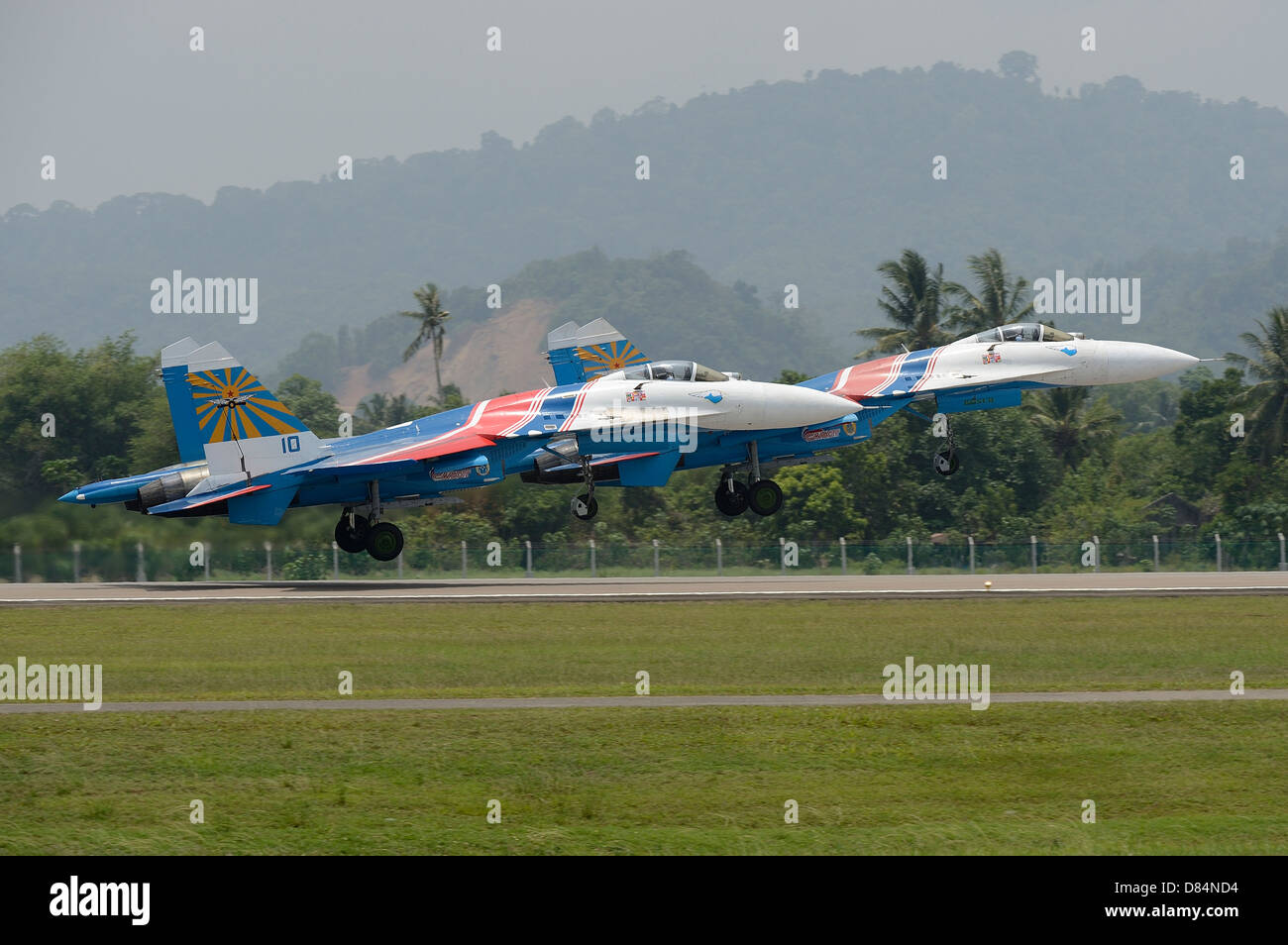 Two Sukhoi Su-27 Flanker of the Russian Knights aerobatic team taking off. - Stock Image