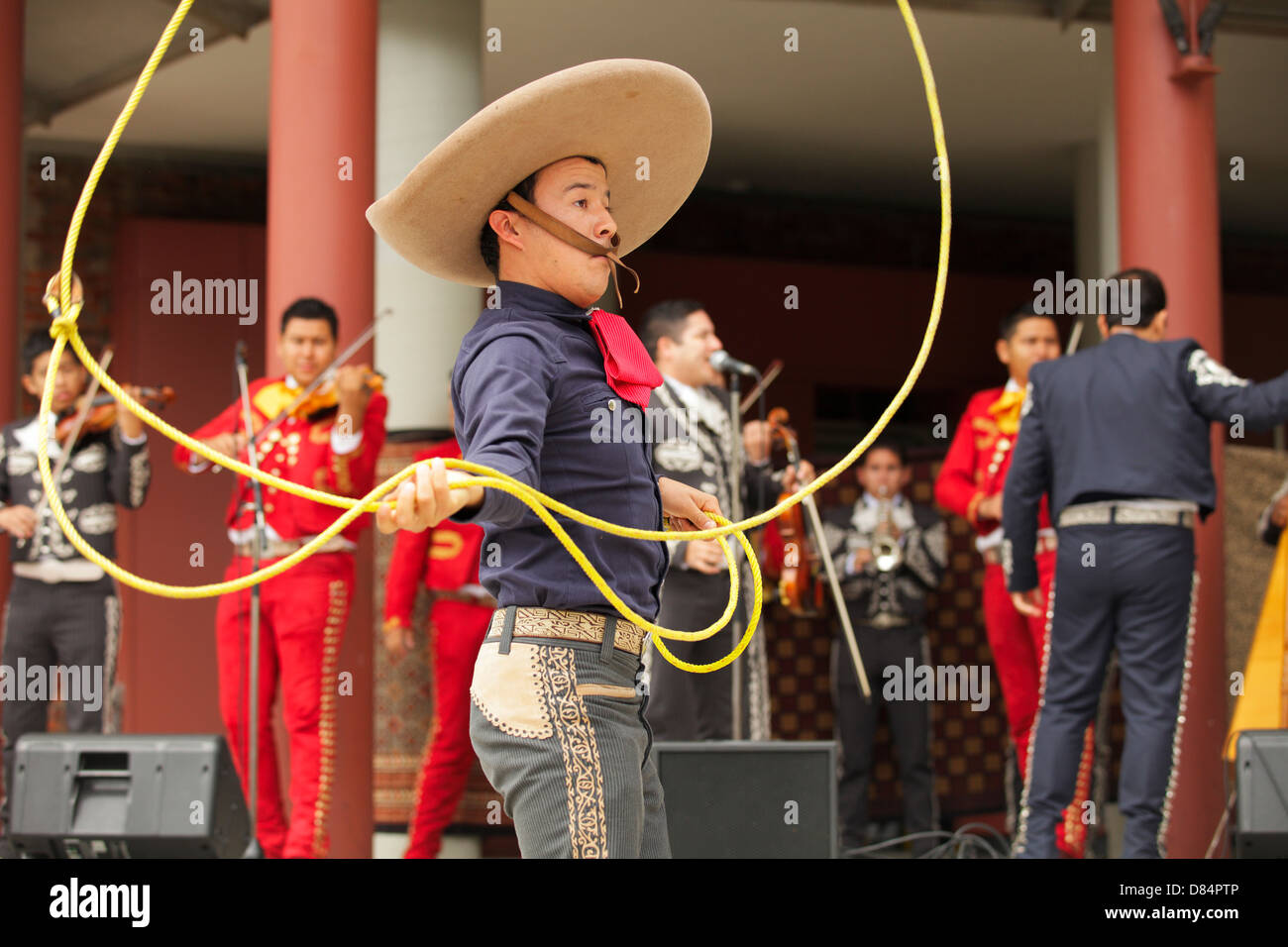 Mexican Mariachi Gaucho performing with lasso in Centennial Square at Africa Fest-Victoria, British Columbia, Canada. - Stock Image