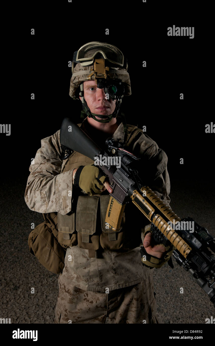 Portrait of a U.S. Marine wearing night vision device. - Stock Image