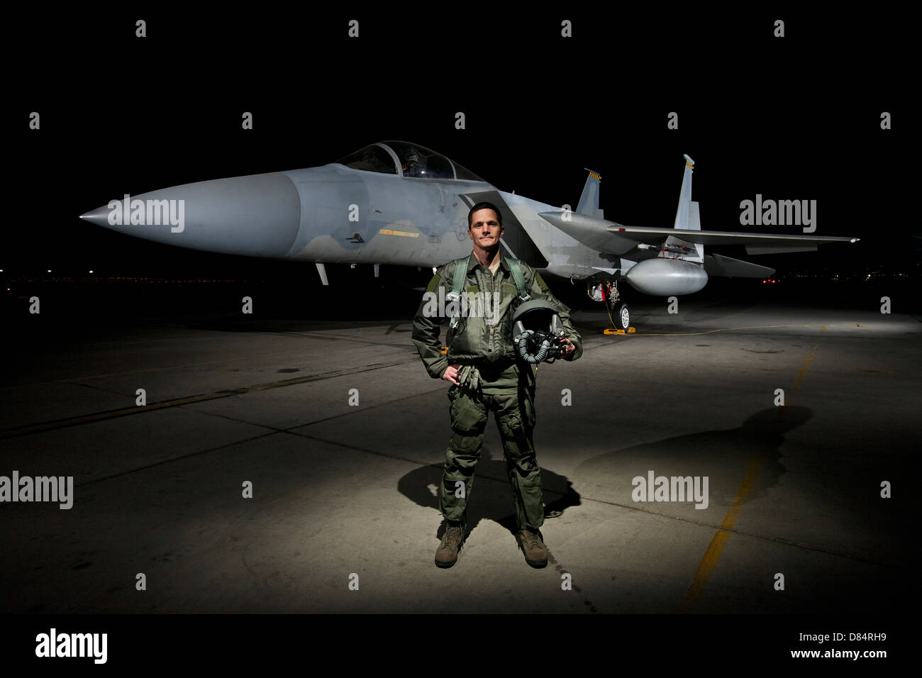 A U.S. Air Force pilot stands in front of a McDonnell Douglas F-15C aircraft. Stock Photo