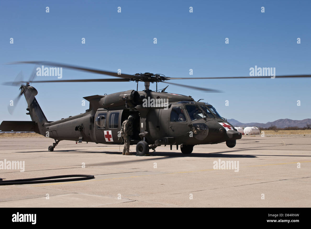 A UH-60 Blackhawk finishes refueling and prepares to taxi away to continue its mission, Davis Monthan Air Force - Stock Image