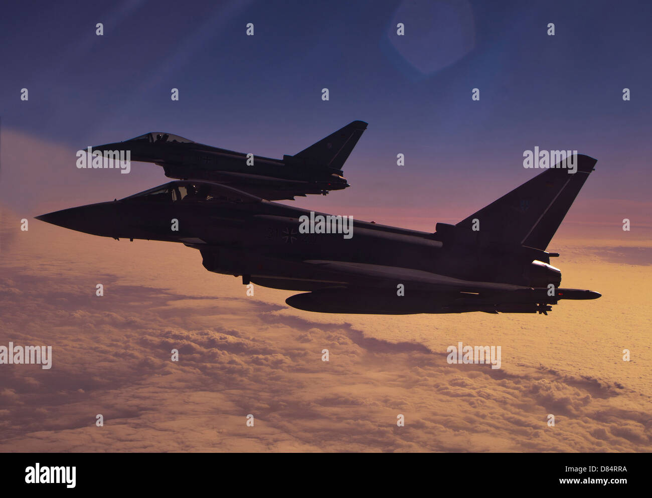 Two German Air Force Eurofighter Typhoon's at sunset. Stock Photo