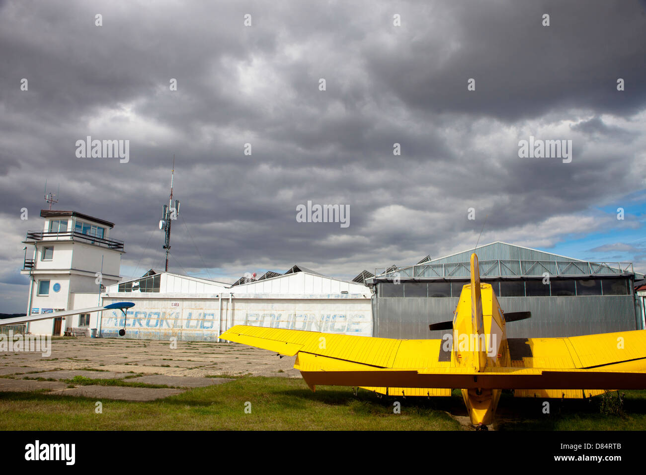 An old communist-era Zlin Z-37A crop spraying aircraft, parked on the apron at Roudnice Airfield, Czech Republic. - Stock Image