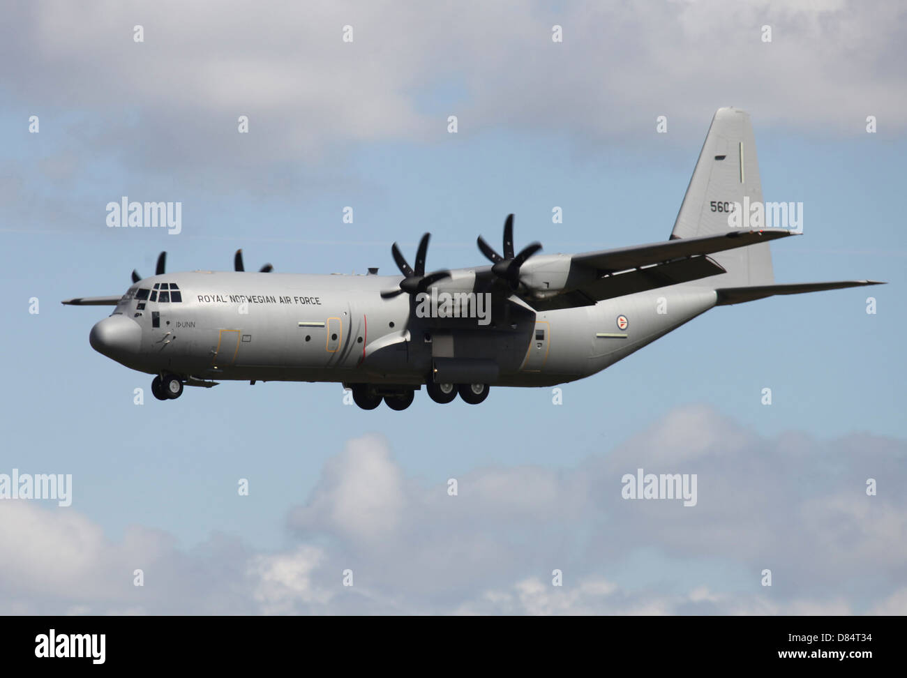A Royal Norwegian Air Force C-130J Hercules landing at Ramstein Air Base, Germany, during the war in Lybia. - Stock Image
