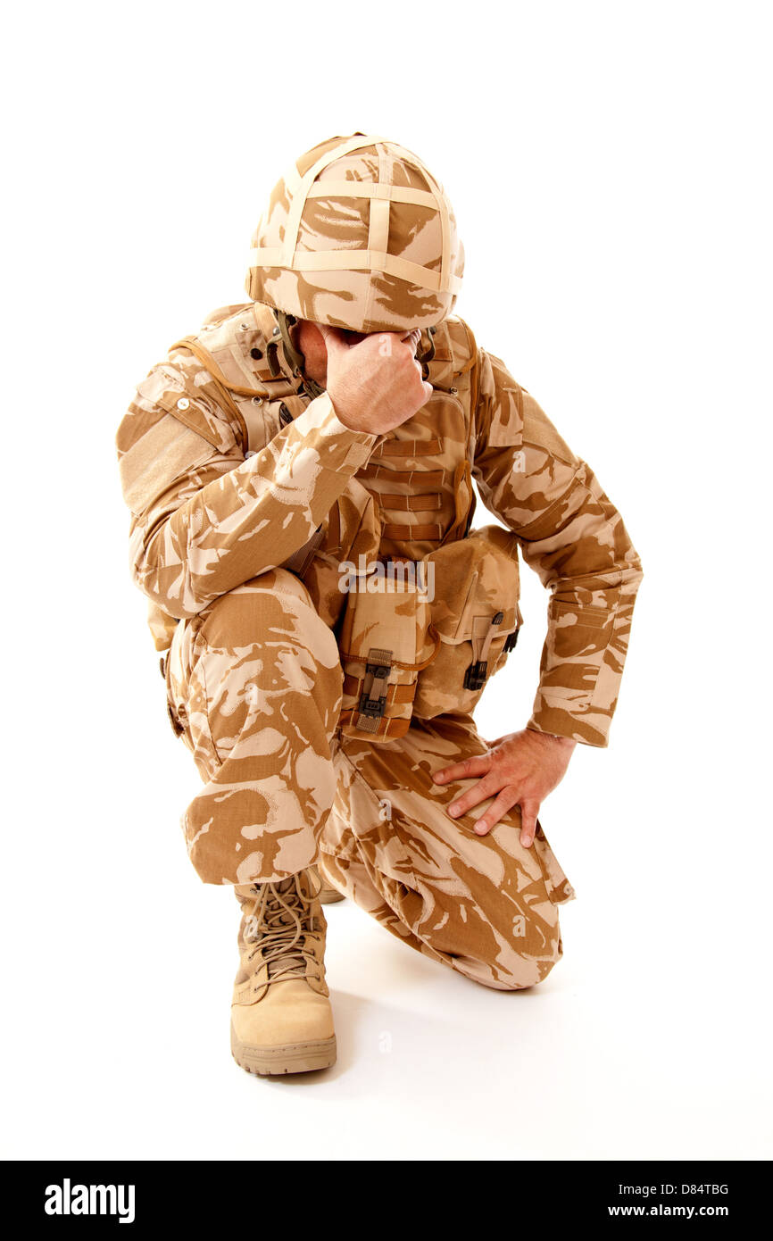 British soldier wearing desert camouflage uniform and suffering frompost traumatic stress disorder. - Stock Image