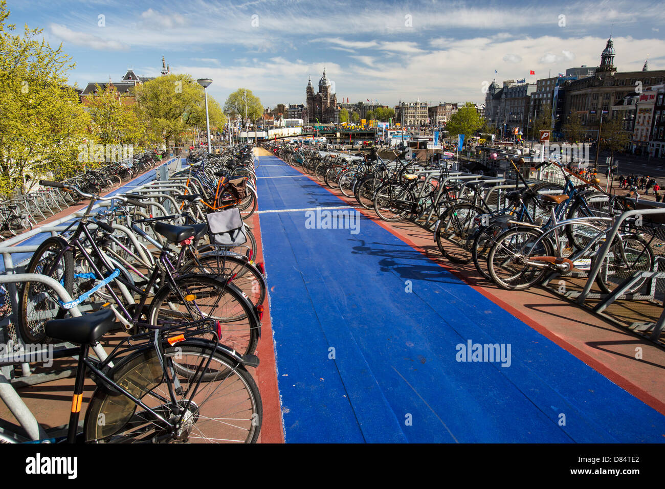 Bikes in bike racks in amsterdam, Netherlands. A huge percentage of the population cycle in this flat, low lying country. Stock Photo