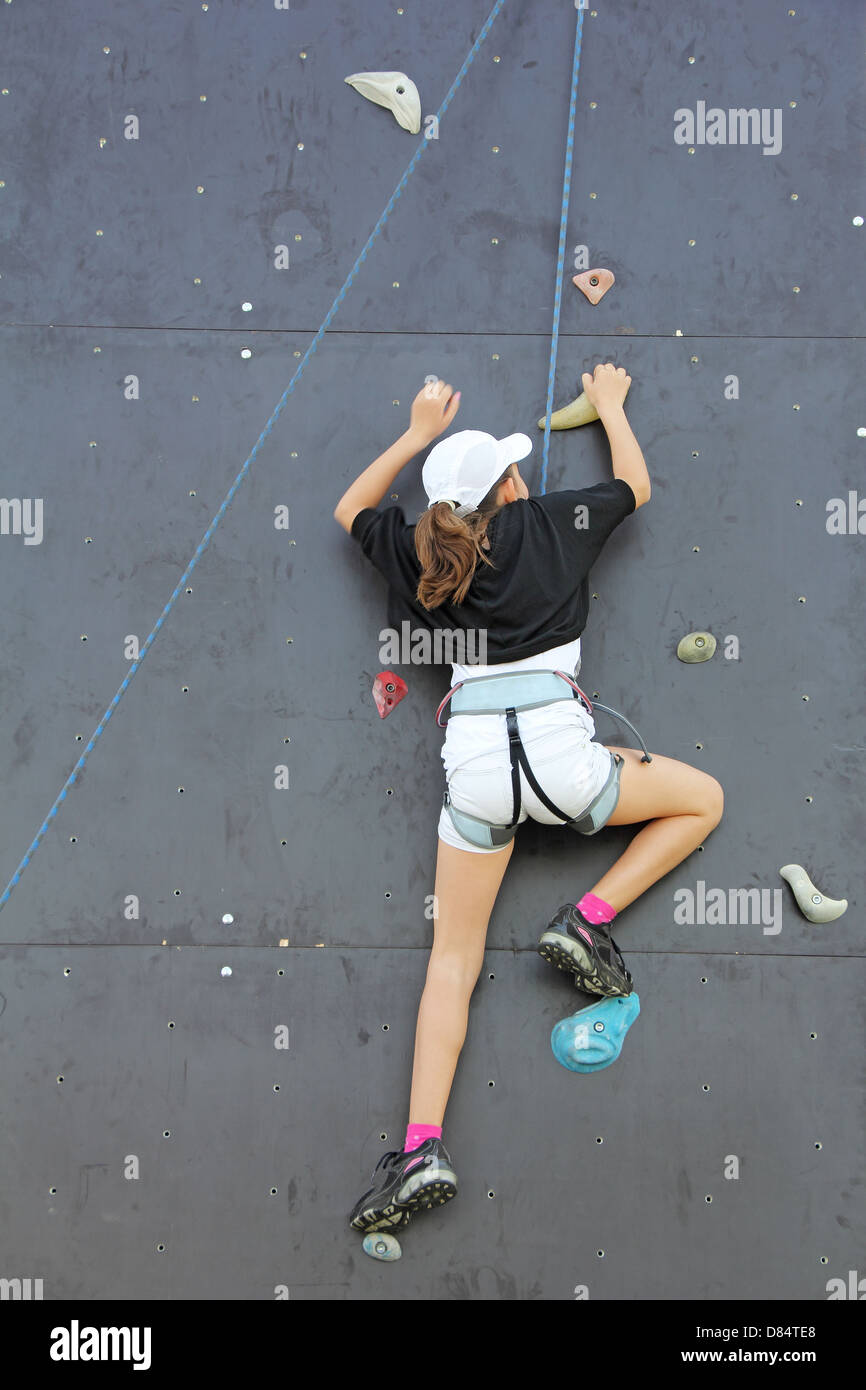 Young climber on an artificial wall, go to the top Stock Photo