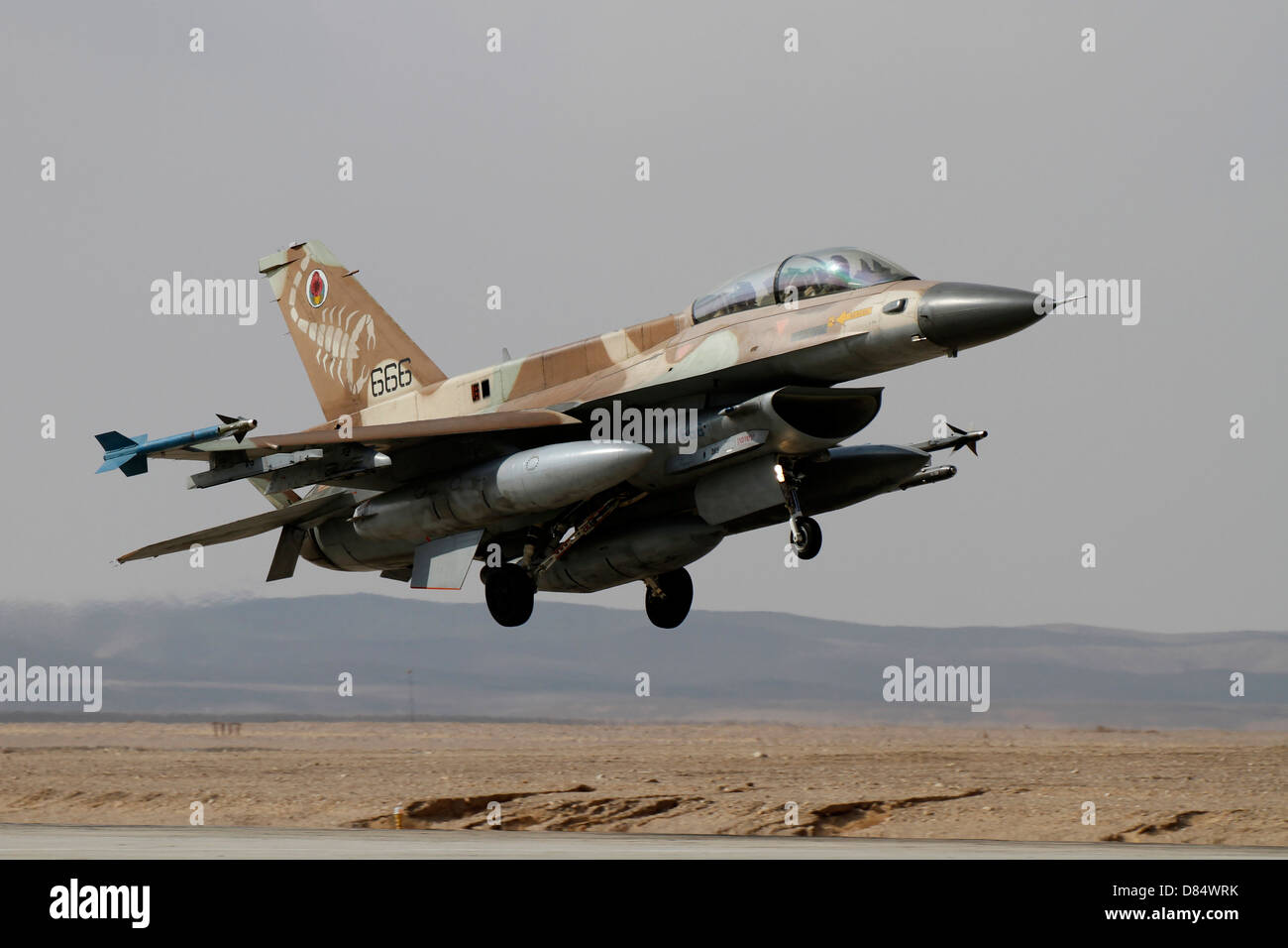 An F-16D Barak of the Israeli Air Force landing at Ovda Air Force Base, Israel. - Stock Image