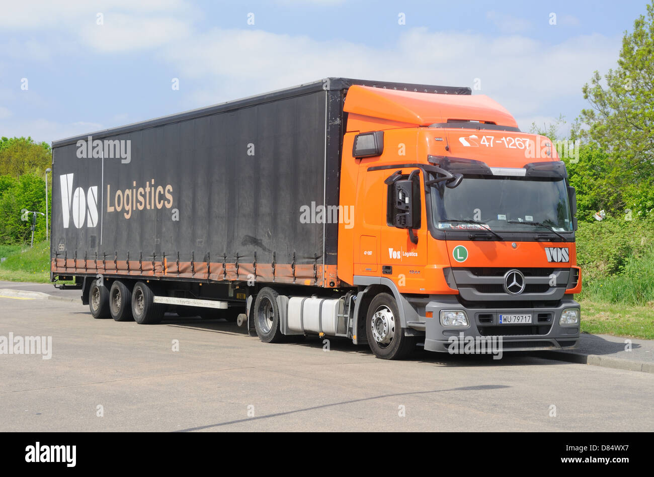 A Polish registered Mercedes 1844 tractor unit & trailer of Dutch carrier Vos Logistics, in Leicester, Leicestershire, - Stock Image