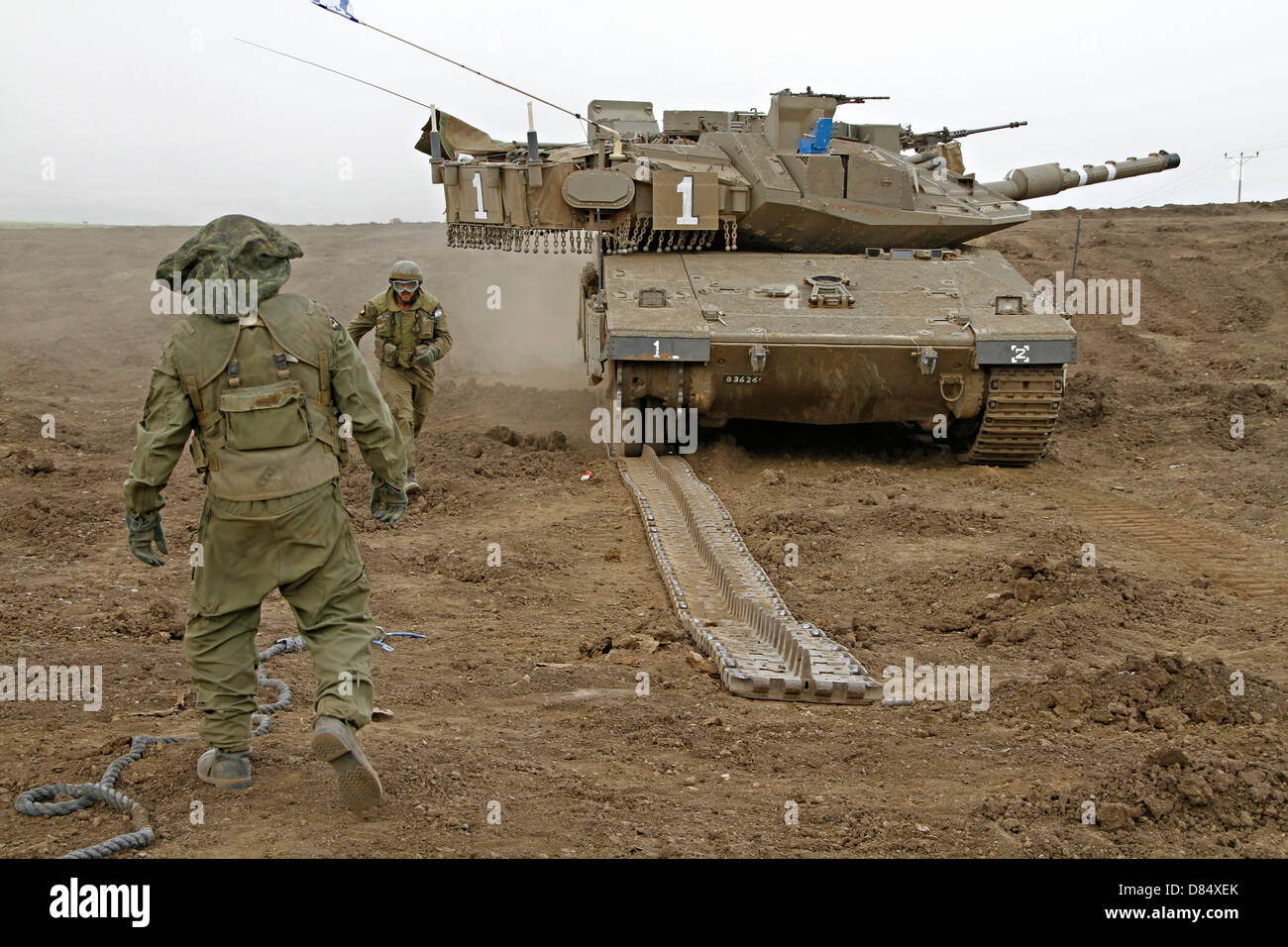 An Israel Defense Force Merkava Mark IV main battle tank during track replacement drill. - Stock Image