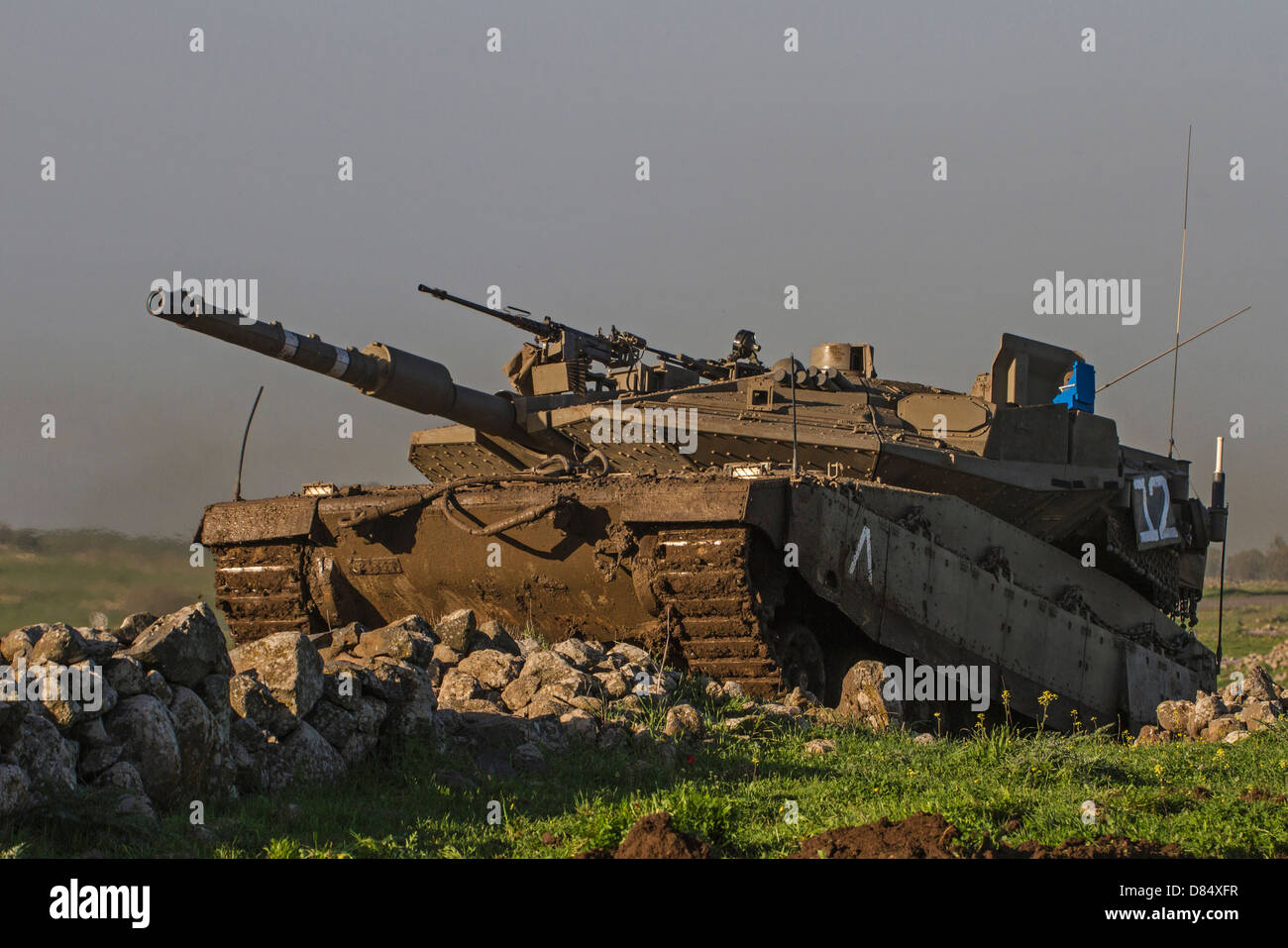 An Israel Defense Force Merkava Mark IV main battle tank during an exercise in the Golan Heights. - Stock Image