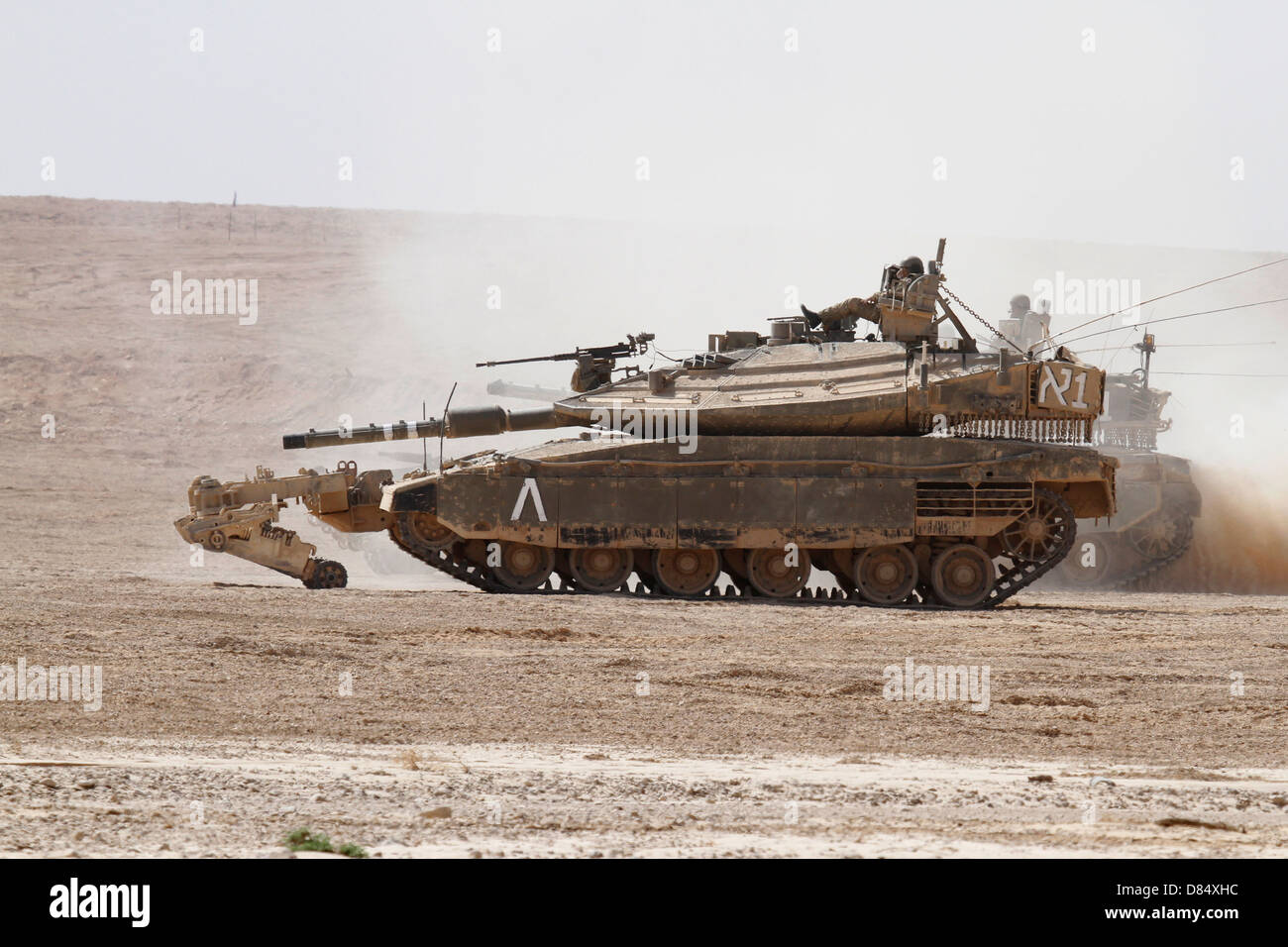 An Israel Defense Force Merkava Mark IV main battle tank with mine clearing device attached to its front. - Stock Image
