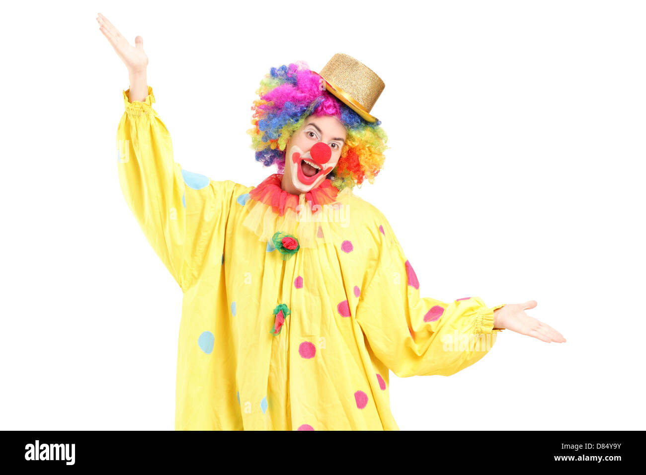 Funny circus clown gesturing with hands isolated on white background - Stock Image