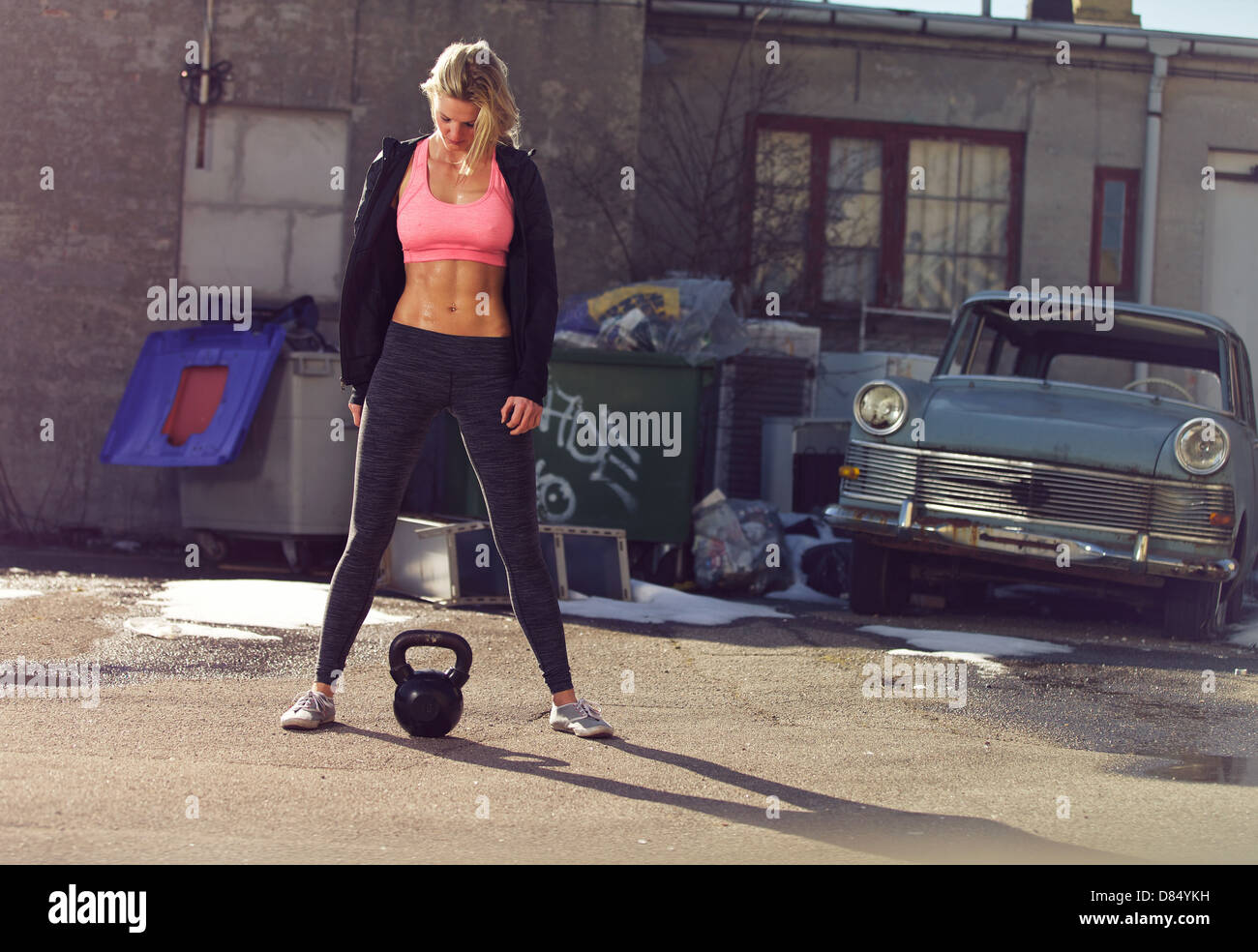 Ghetto girl with kettlebell in a crossfit training outdoor - Stock Image