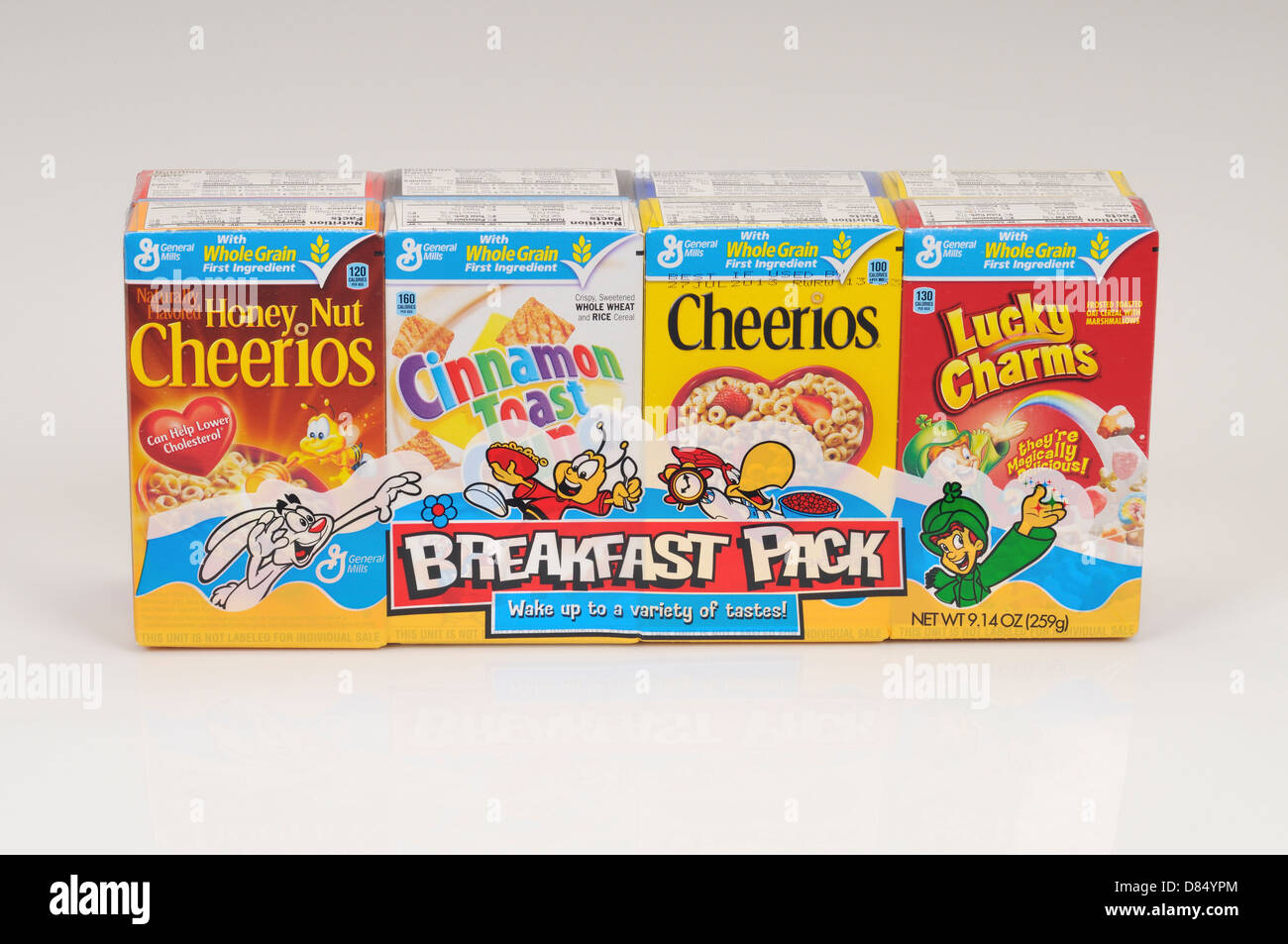 Breakfast pack of boxes of General Mills cereals of cheerios lucky charms and cinnamon toast on white background - Stock Image