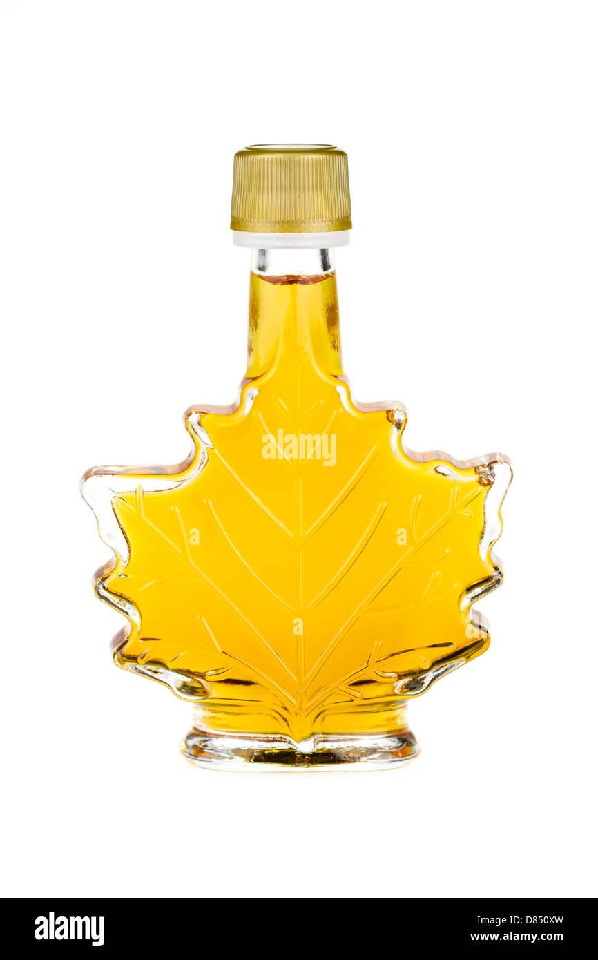 Maple syrup bottle isolated on a white background. - Stock Image